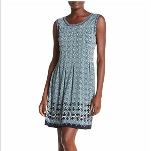 Green and blue sleeveless patterned dress